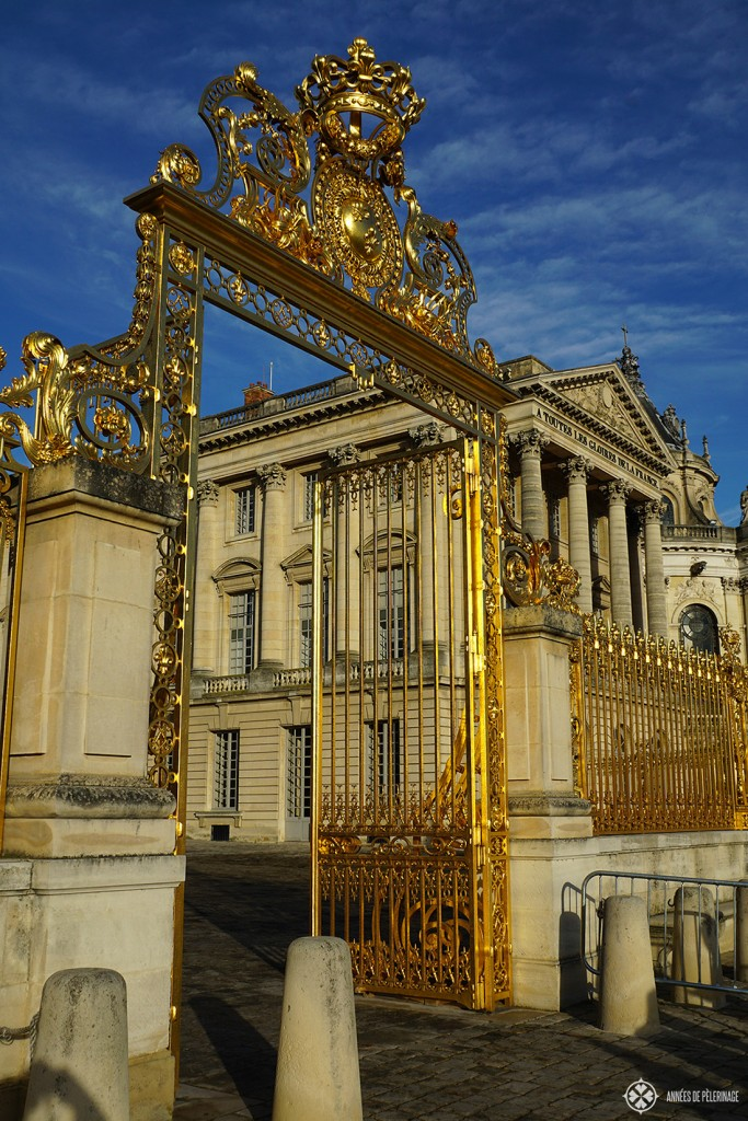 The golden entrance gates of Versailles Castle in Paris