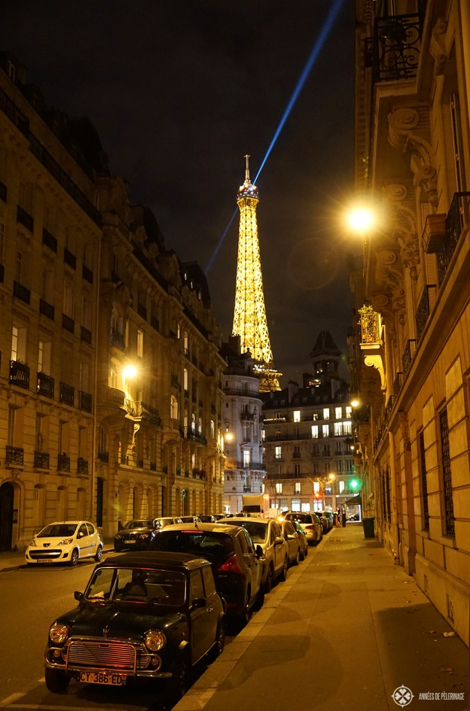 Paris at night - a wonderful street scene with the Eifel Tower in the background