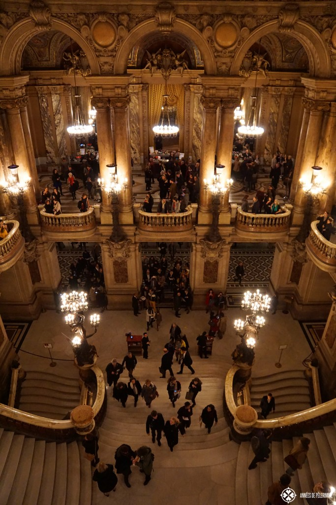 The fabulous staircase of the Opéra Garnier in Paris. Put viewing a performance on your list of things to do in Paris to see it with a black tie crowd