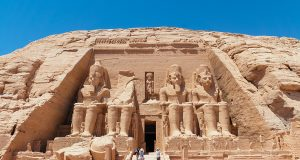 Front view of Abu Simbel with the gigantic statues of Ramses II