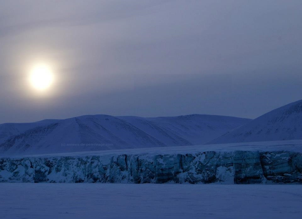 sunset over a glacier on svalbard on the east coast at the end of a long day of polar bear watching