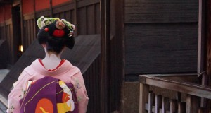 Maiko walking down the hanamachi lane in Kyoto