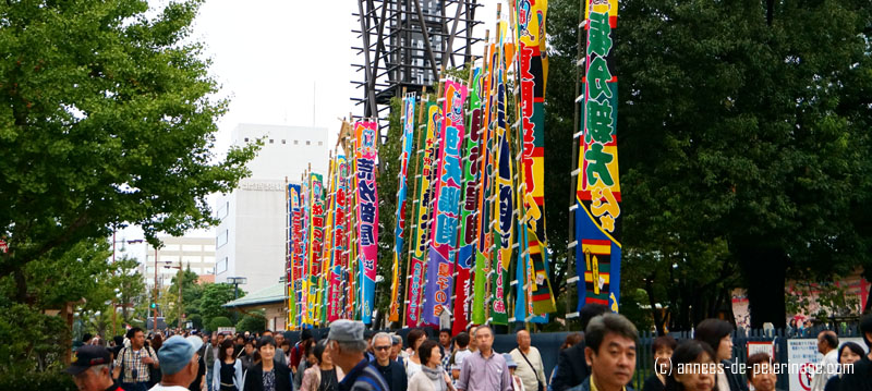 colorful banners anouncing the sumo wrestlers of the upcoming tournament day