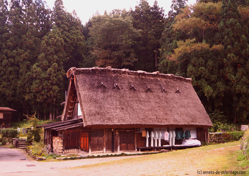 A Gasshō-zukuri farmhouse with laundry on the porch in shirakawa-go, japan