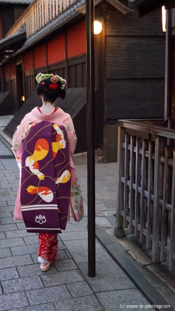rear view of a geisha (meiko) in hanami lane, gion, kyoto
