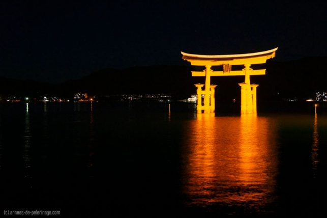 The ret torii of Itsukushima shrine in miyajima at night