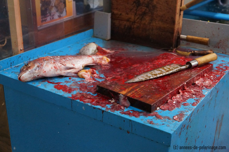 A gory fish on a wooden knife block at tsukiji fish market in tokyo