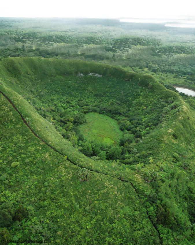 inactive volcano crater covered in dense shrubery in mauritius