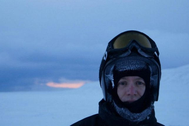 me in spitsbergen, svalbard, after a very long day driving on the snowmobile