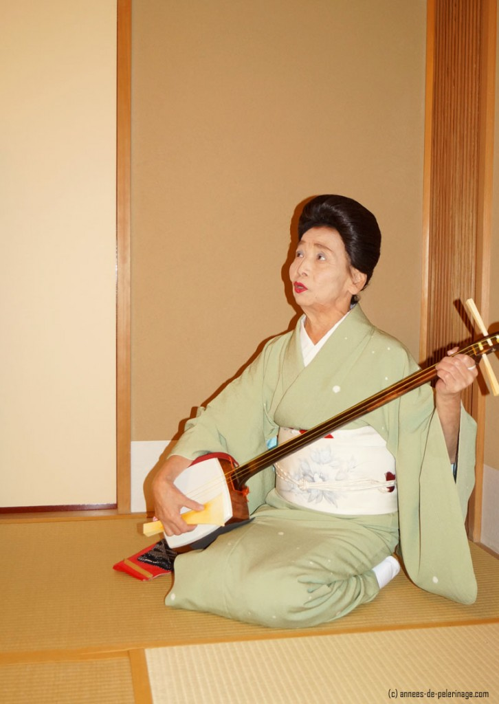 A former geisha playing the shamisen