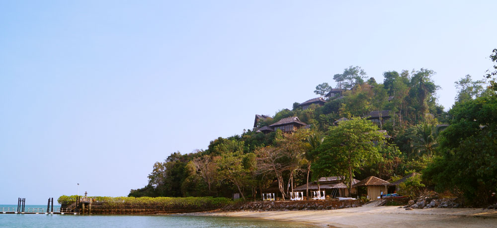 The pier of Six Senses Koh Yao Noi and the private villas on the hill