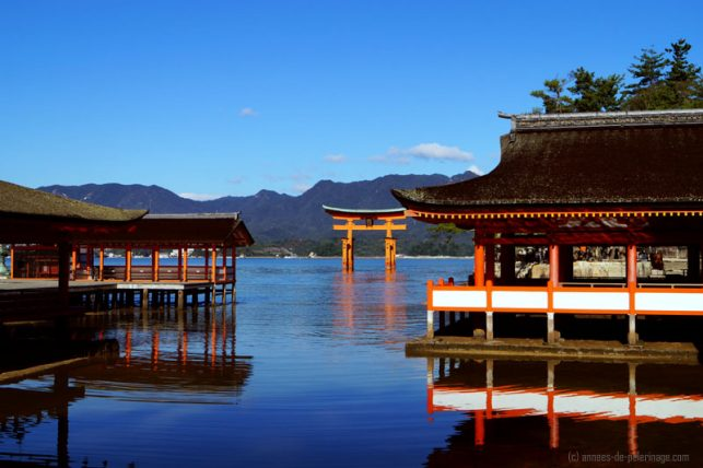 The red torii of Itsukushima shrine in miyajima at full tide with