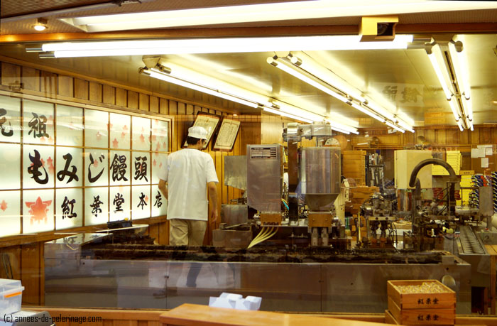 sweat cake factory in miyajima producing Momiji Manju