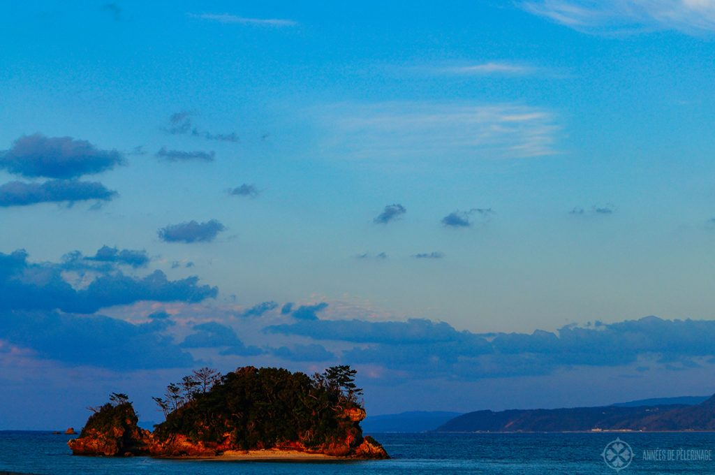 a small island off the coast of Okinawa near sunset