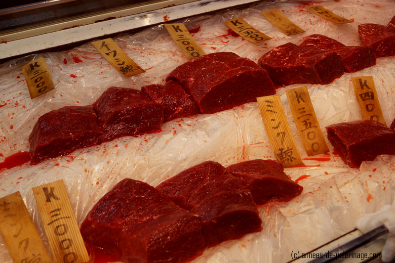 whale flesh being auctioned at the tsukiji fish market in tokyo