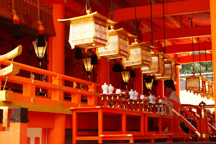 Shinto priest performing a service at fushimi taisha shrine in Kyoto, Japan
