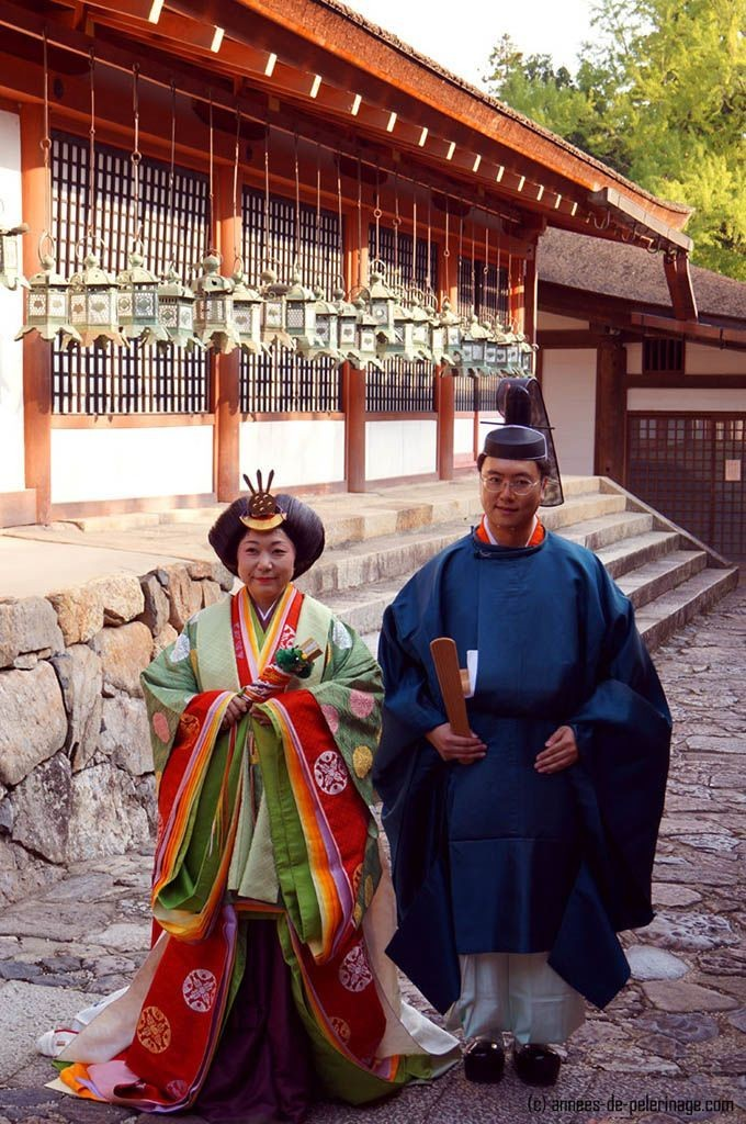 A wedding couple dressed like court nobles (Jūnihitoe) from the nara period in japan seen in Kasuga Taisha