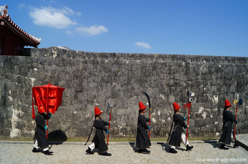 A procession of actors in the shuri castle in naha, okinawa, japan