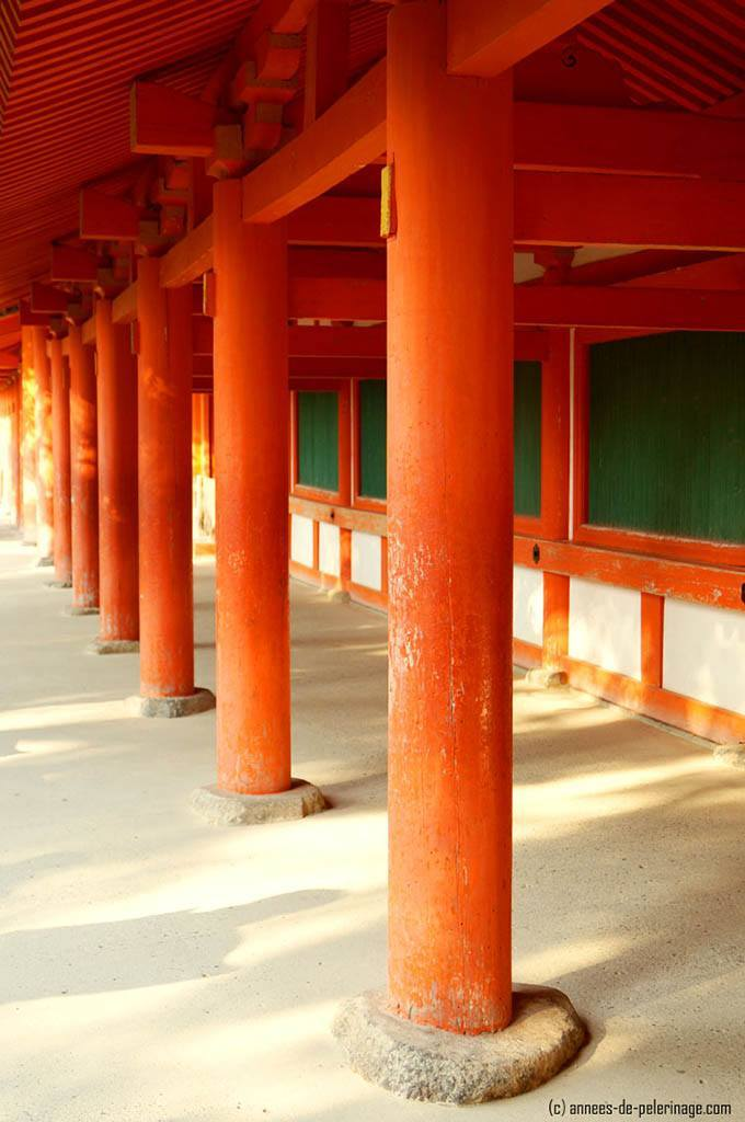 second before I saw the woman wearing the junihitoe the red painted corridors at the Kasuga Taisha Shinto Shrine in Nara