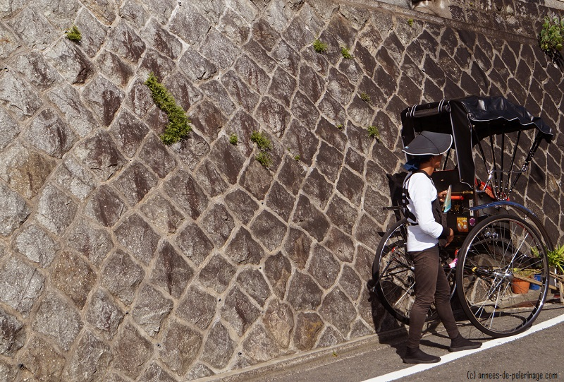 A rickshaw standing against a wall in front of Kiyomizu-dera in Kyoto