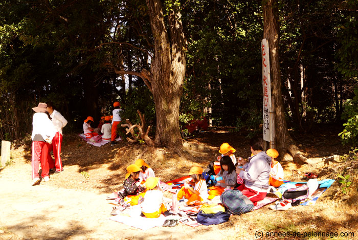 school children picnic at fushimi inari shrine in Kyoto, Japan