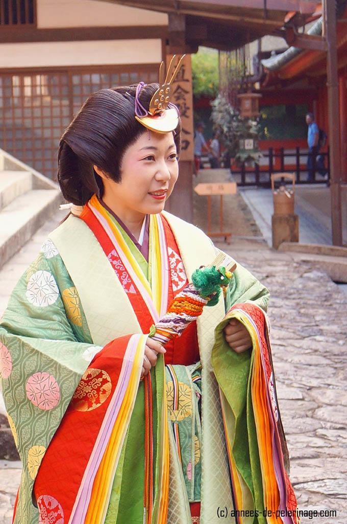 Close-up of the woman wearing a junihitoe from the Heian era
