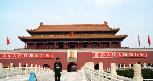 The main gate to the Forbidden City in Beijing with a soldier guarding the Mao entrances