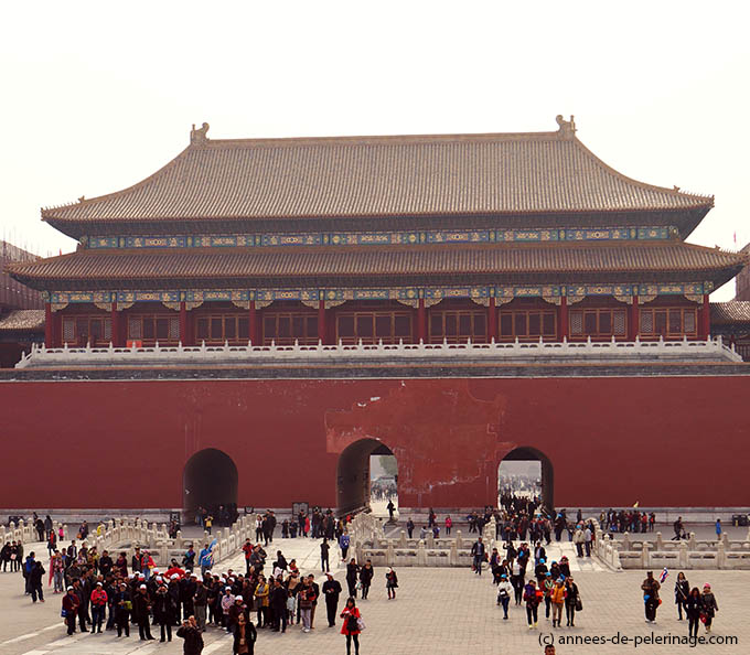 Merdian Gate with its three big red arches marking the entrance of the Forbidden City in Beijing