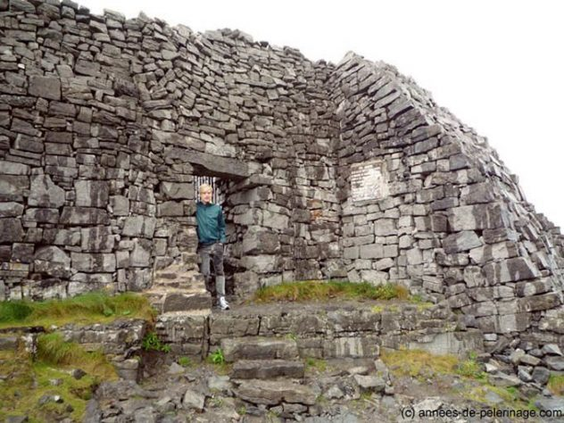 Me entering the prehistoric stone rings of Dún Aonghasa through a small gate