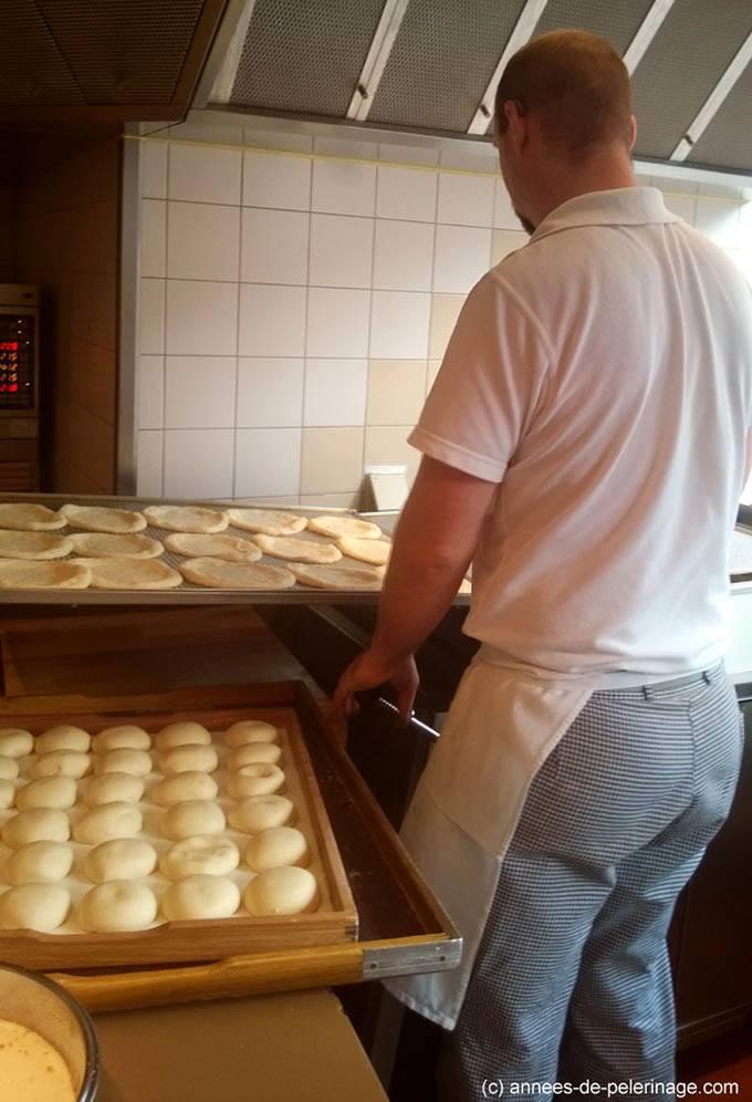 inside cafe frischhut viktualienmarkt - preparing fresh fried dough food