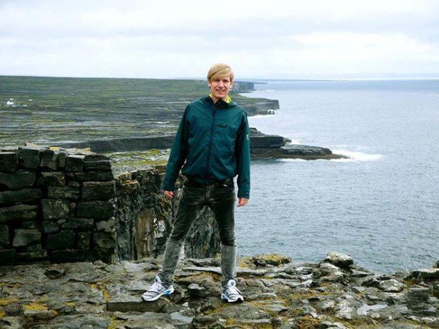 me on vertical cliffs in Dún Aonghasa, Ireland