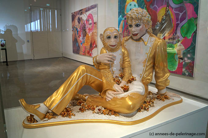 The golden ceramic Statue of Micheal Jackson hold his chimapnzee Bubble by Jeff koons in Astrup fearnley Museeum in Oslo