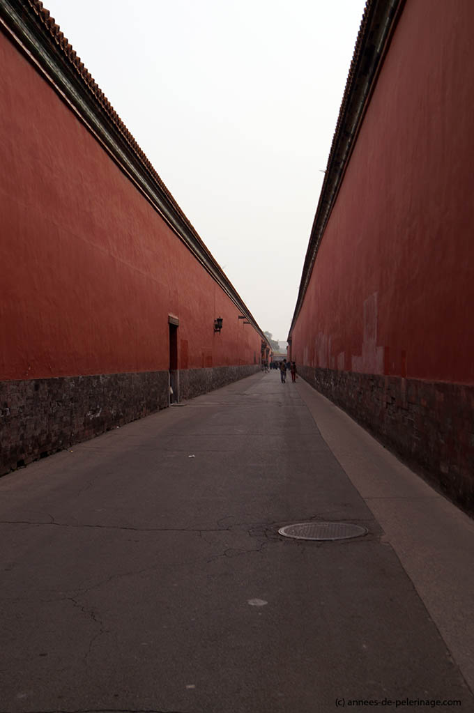 The red walls of the forbidden city in beijing - endless coridors hiding ancient treasures