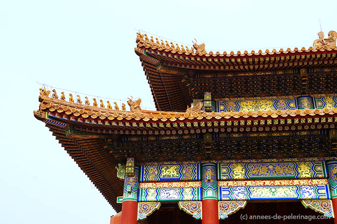 Rooftop detail with 9 glazed-tile dragons in the Forbidden City in Beijing