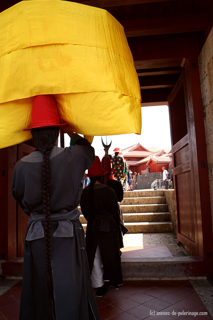 Armsman carrying silk umbrella during Shuri Castle Festival, Okinawa