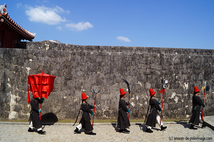 5 black military men during the Parade of the vassals at shuri castle festival