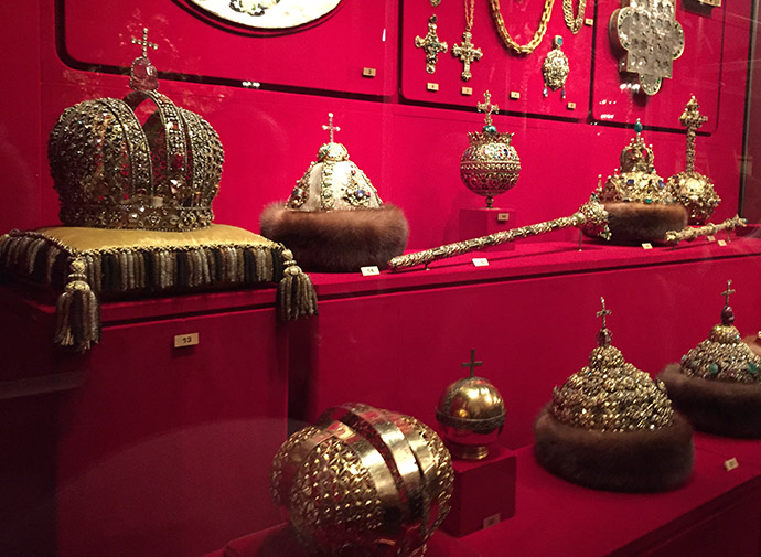 The crowns of the tsars rowed up in a cabinet in the armoury in kremlin