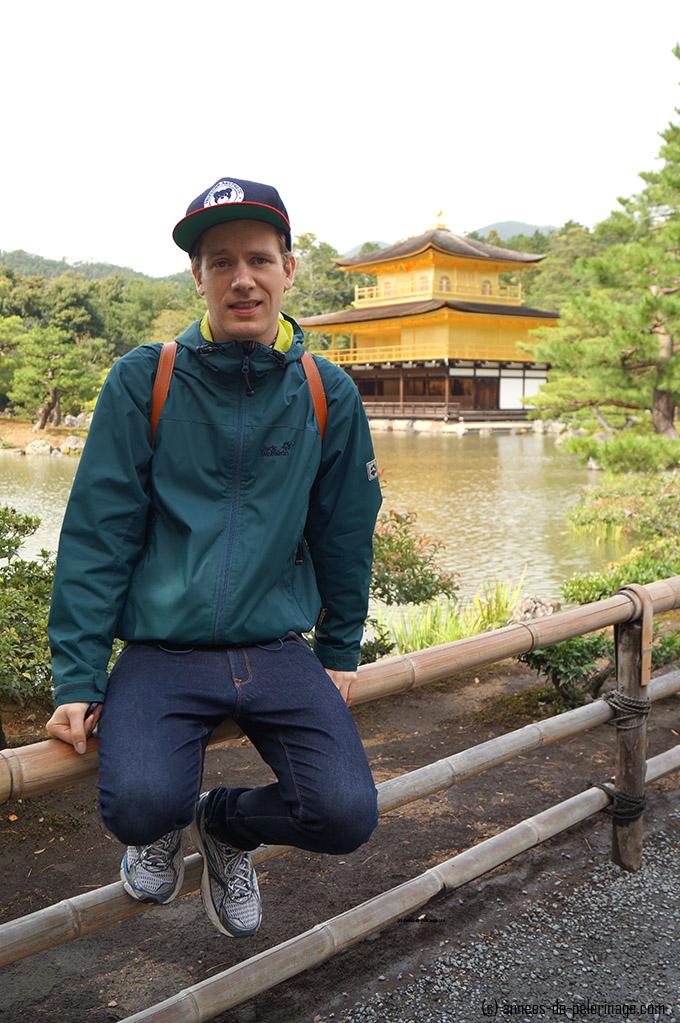 Me sitting in front of the golden pavilion of kinkaku-ji