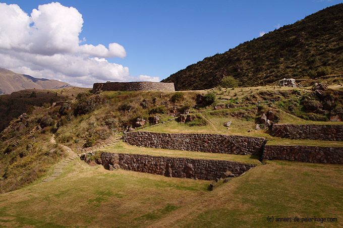 the fortress of ahua huaca in tipon sitting on a hill above the inca terraces