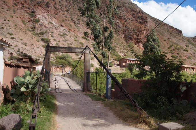 The bridge leading to the entrance to the maras salt mines from the Urubamba valley