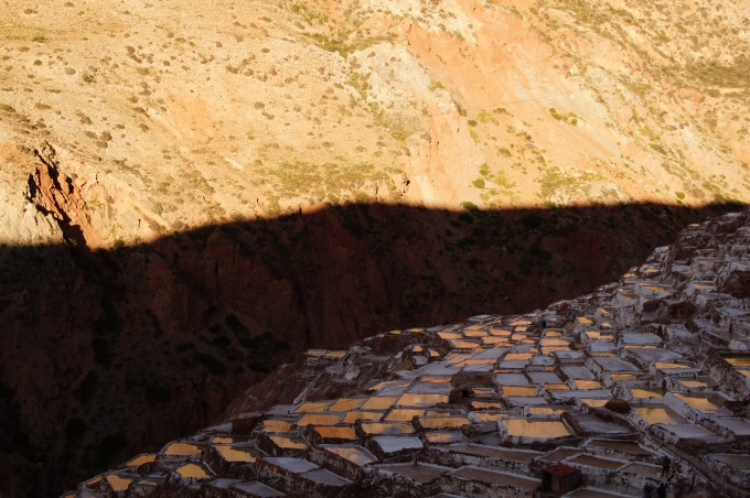 Sunset with orange reflections in the Maras Salt evaporation ponds