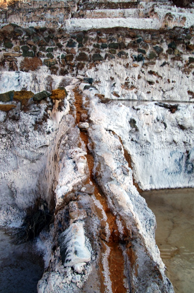 The water distribution channels of the Maras salt mines in Peru