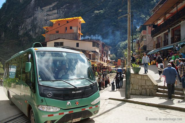 The bus in aquas calientes taking tourists up the road to machu picchu
