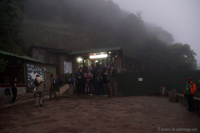 The entrance of Machu Picchu at 6 am in the morning before dawn hidden in the mists