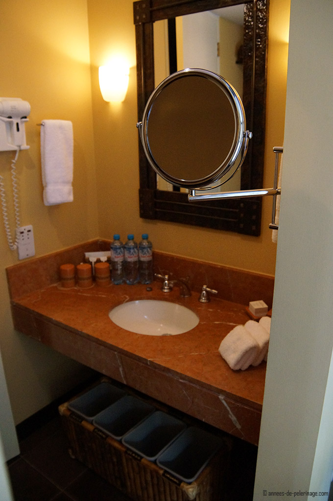 The tiny bathroom of the belmond sanctuary lodge luxury hotel - sink, hairdryer, mirror and bathing kit all on 2 square meter