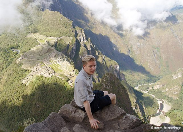Me sitting on the summit of wayna picchu with machu picchu in the background