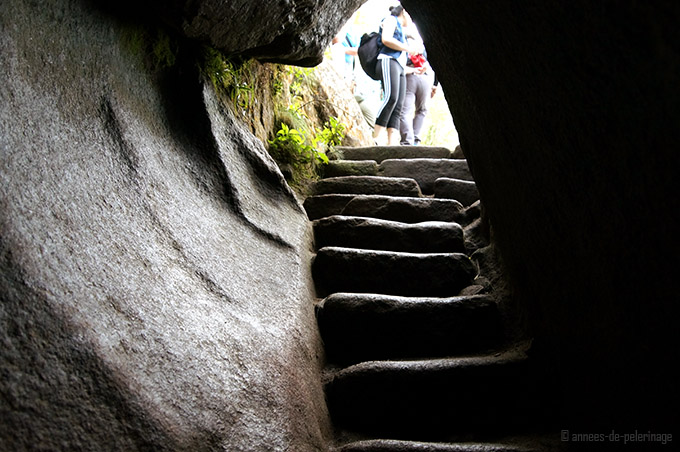 A granite tunnel on the way up to wayna picchu