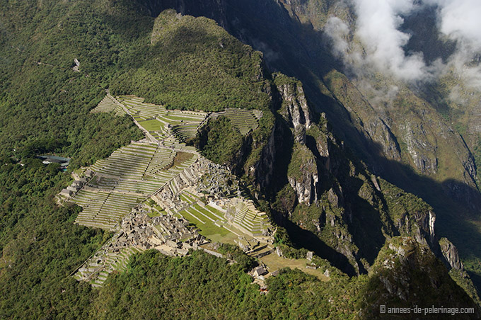 The view on the belmond Sanctuary Lodge and the inca ruins of Machu picchu in general taken from the peak of wayna picchu