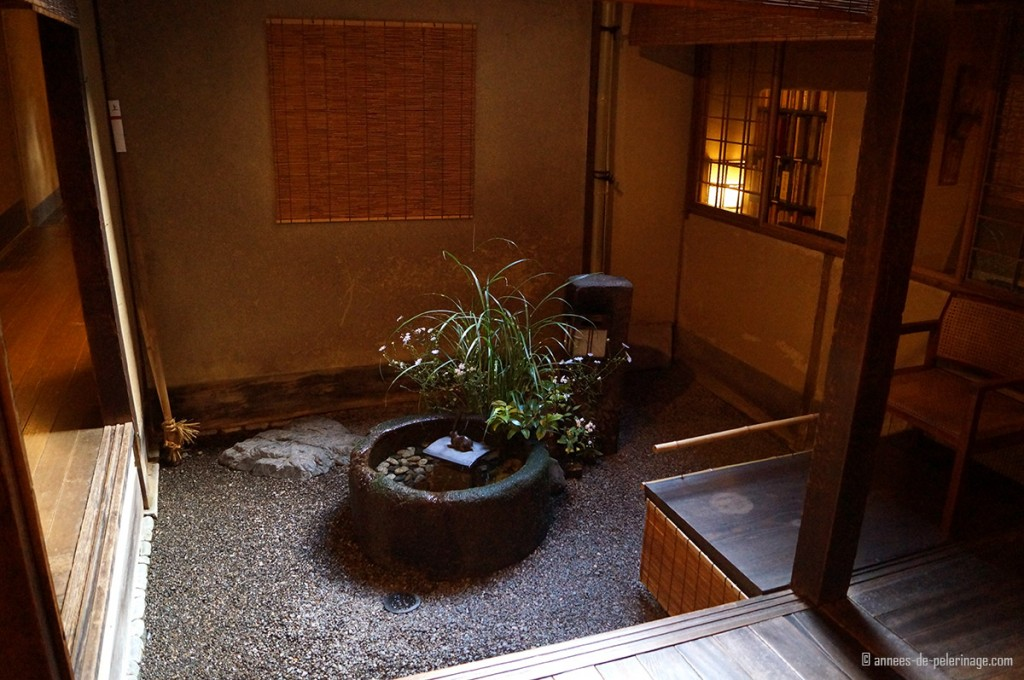 courtyard with plan and fountain tawaraya ryokan