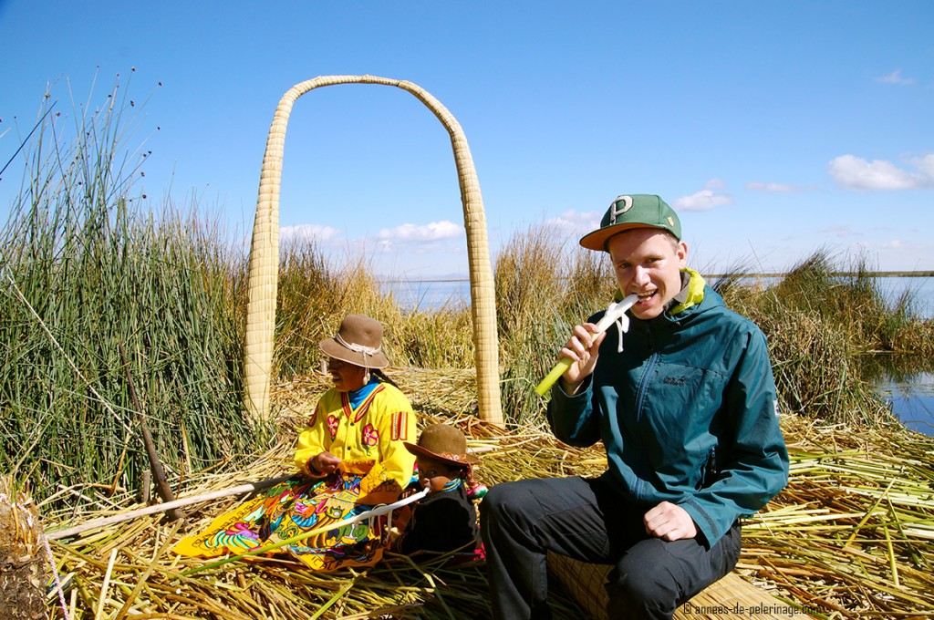 Me eating the bottom half of the totora reeds - the main staple of thei Uros' diet. For lake Titicaca you will need to pack warmer clothes as you can see